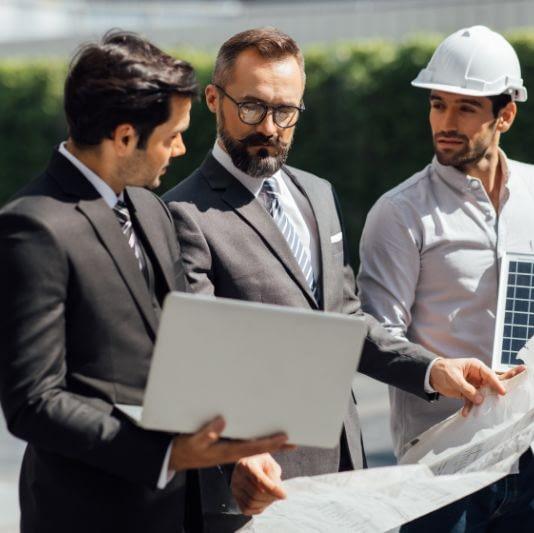 men discussing building plans