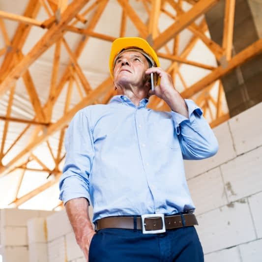 man in new construction building